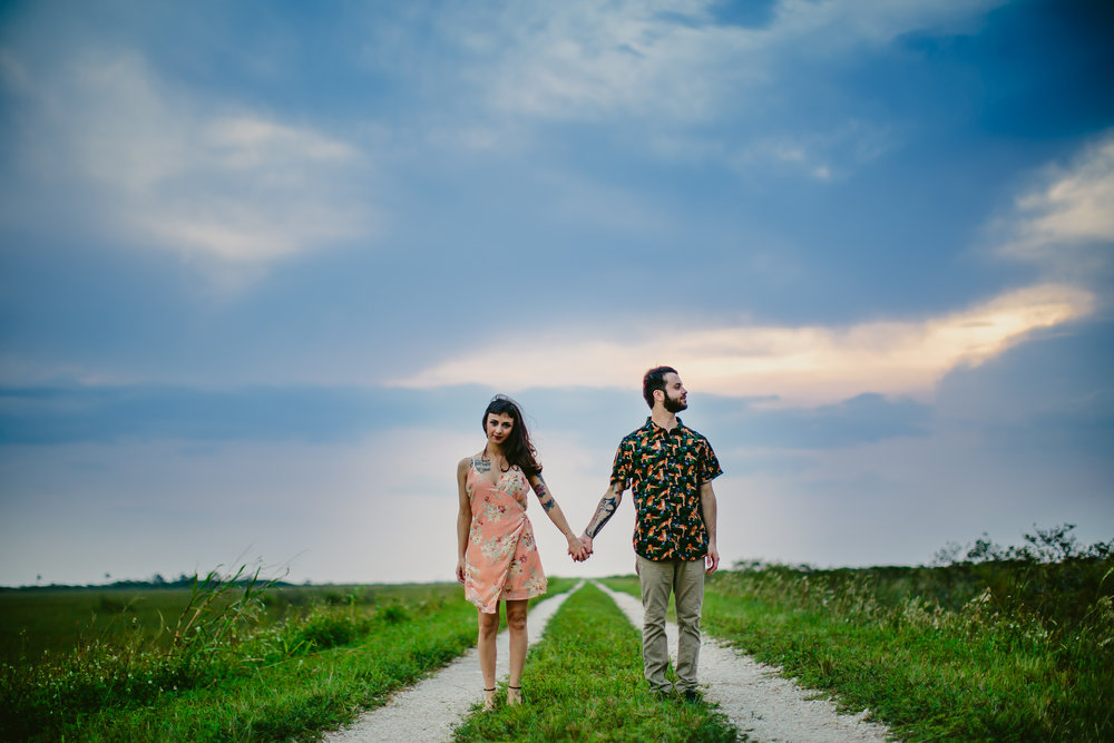 hipster-couple-holding-hands-tiny-house-photo-south-florida-documentary-wedding-photographer.jpg
