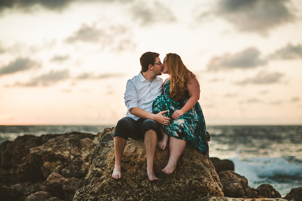 kiss-engaged-couple-beach-south-florida-wedding-photographer-tiny-house-photo.jpg