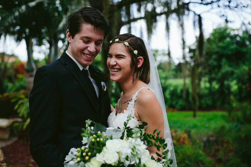 bride_groom_rainy_wedding_day_laughter_love_tiny_house_photo.jpg