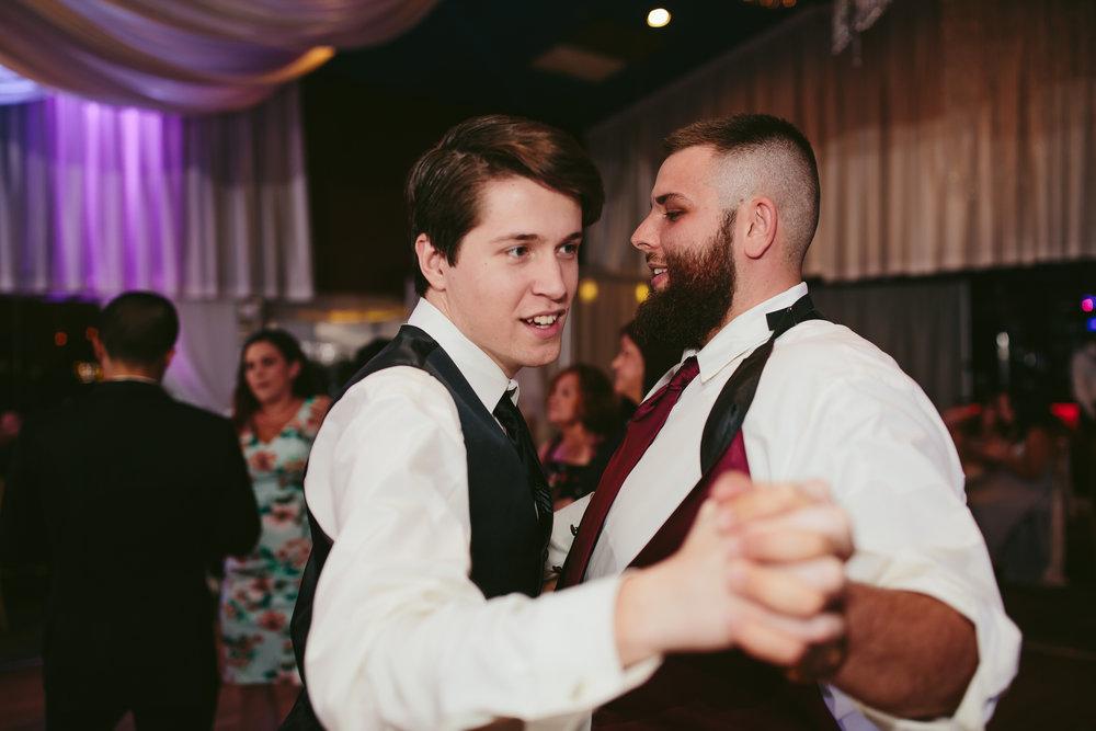 groom_dancing_groomsman_tiny_house_photo_moments_wedding_day.jpg