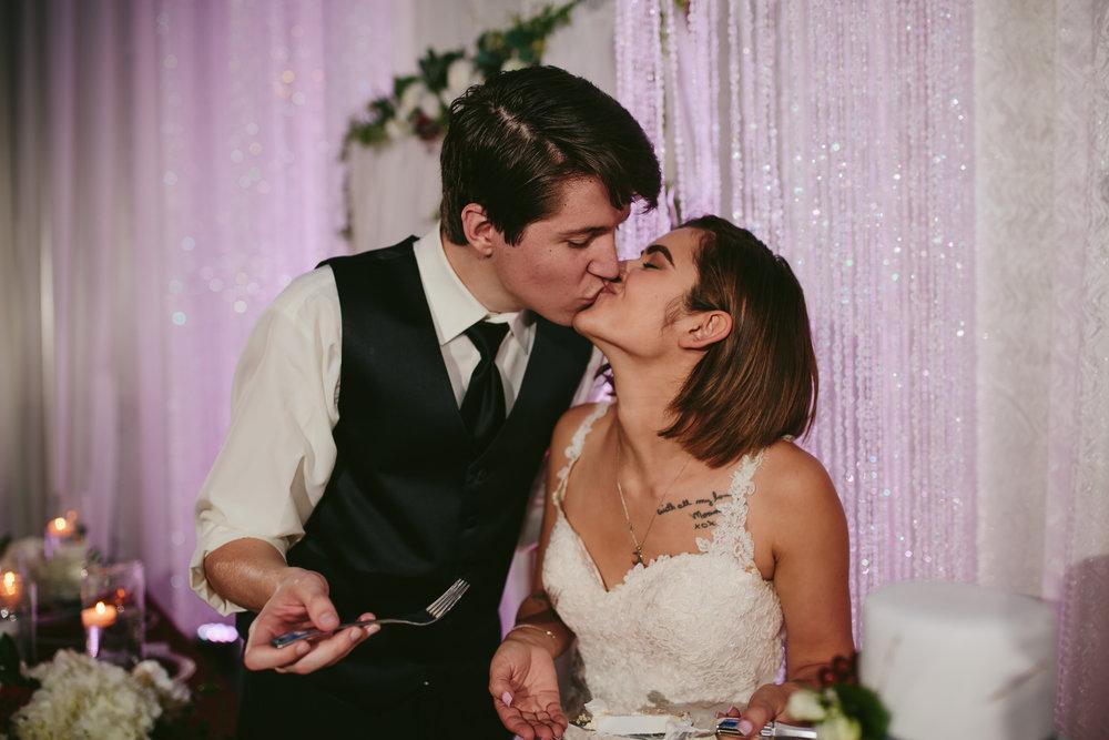 kissing_bride_groom_cake_tiny_house_photo.jpg
