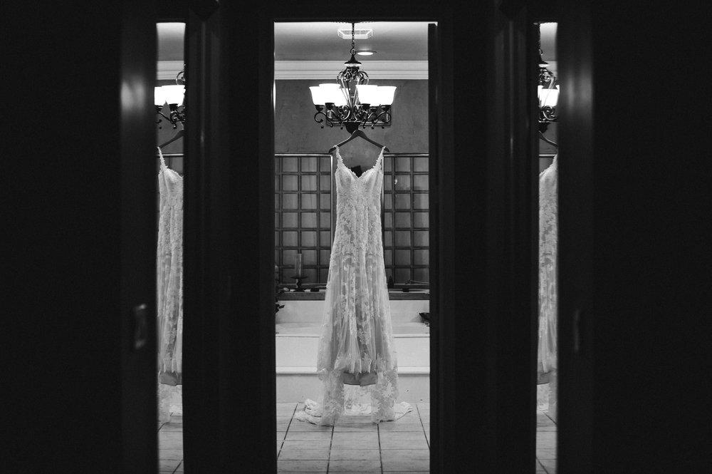 wedding_dress_hanging_tiny_house_photo_black_and_white.jpg