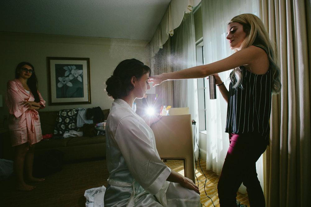 hairspray-bride-getting-ready-destination-wedding-photographer-tiny-house-photo.jpg