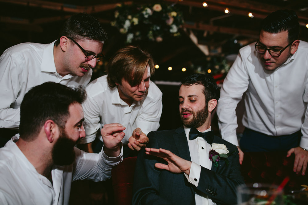 tiny-house-photo-moments-groom-bros-showing-off-ring-funny-moment-driven-wedding-photography-tiny-house-photo.jpg