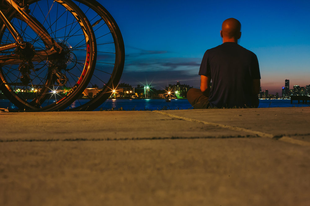 Adam critical mass miami sitting night portrait