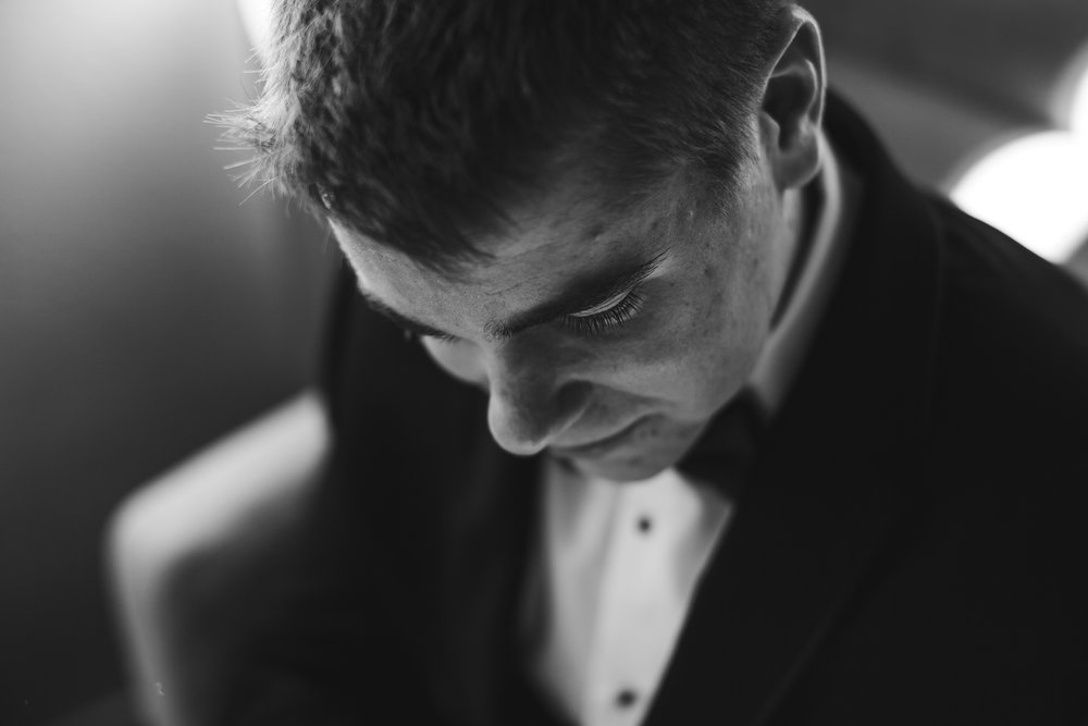 emotional_intimate_wedding_photographer_groom_getting_ready_tiny_house_photo_international_photographer.jpg