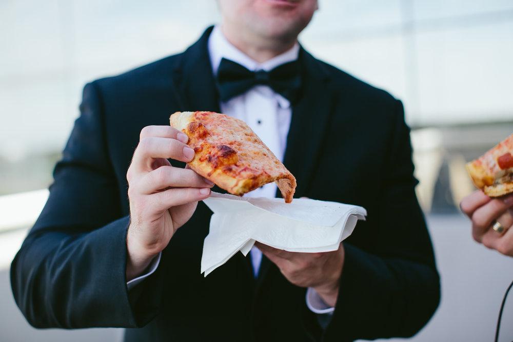 groom_eating_pizza_moment_driven_wedding_photographer_tiny-house_photo.jpg
