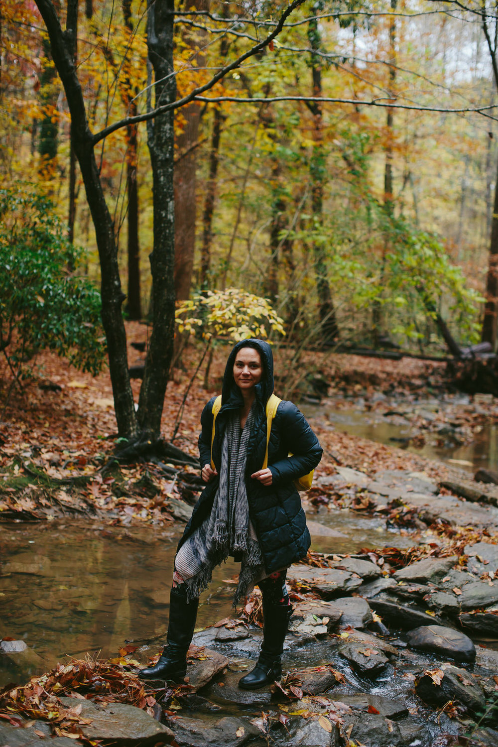 me hiking across a creek in roswell georgia in the fall foilage