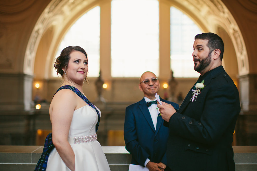 bride_smirk_funny_san_francisco_city_hall_wedding_ceremony.jpg