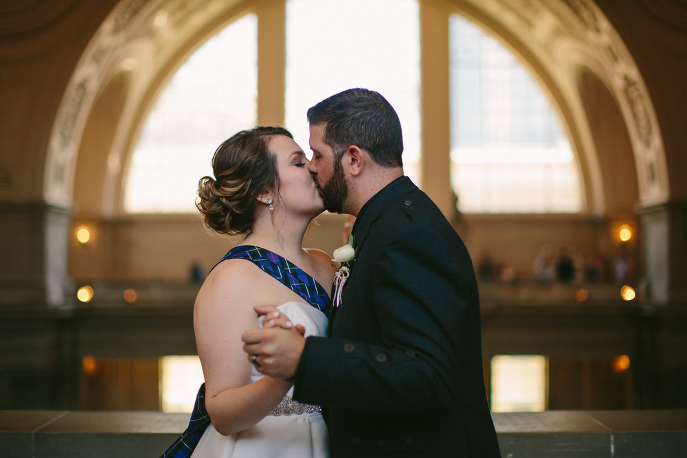 first_kiss_husband_wife_intimate_wedding_san_francisco_city_hall.jpg