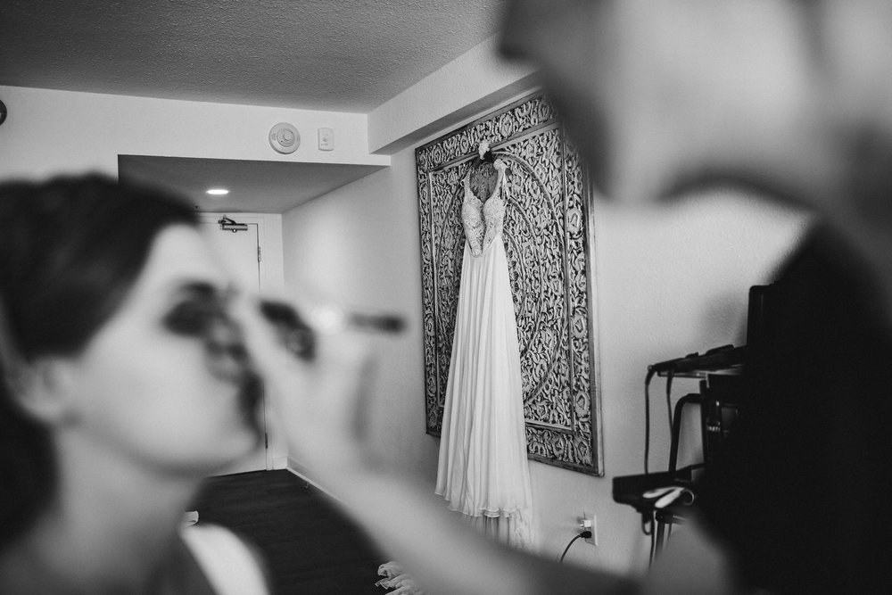 bridal_makeup_getting_ready_room_dress_hanging.jpg