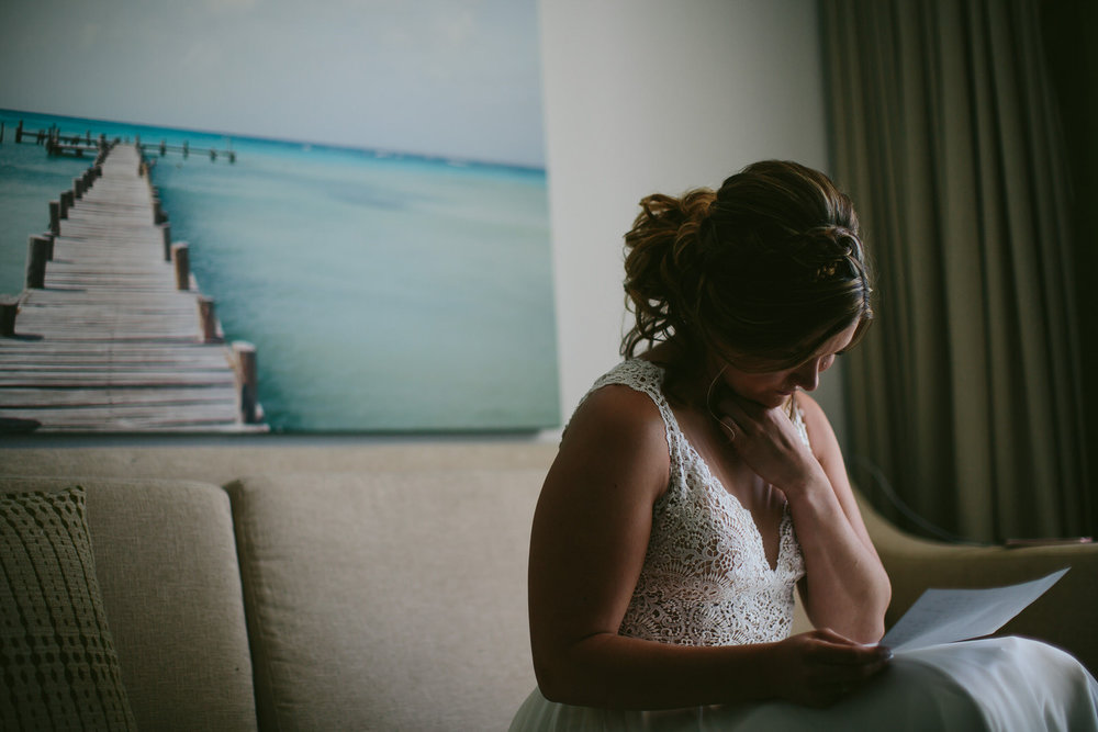 bride_reading_note_lgbtq_wedding_amara_cay_resort.jpg