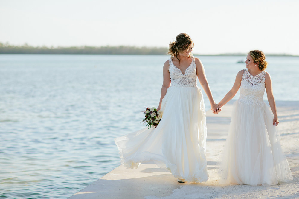 brides_walking_holding_hands_love_wedding_photography.jpg