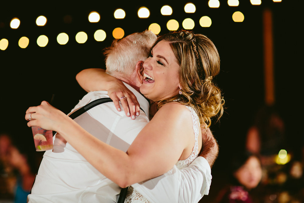 bride_hugging_grandpa_wedidng_reception.jpg