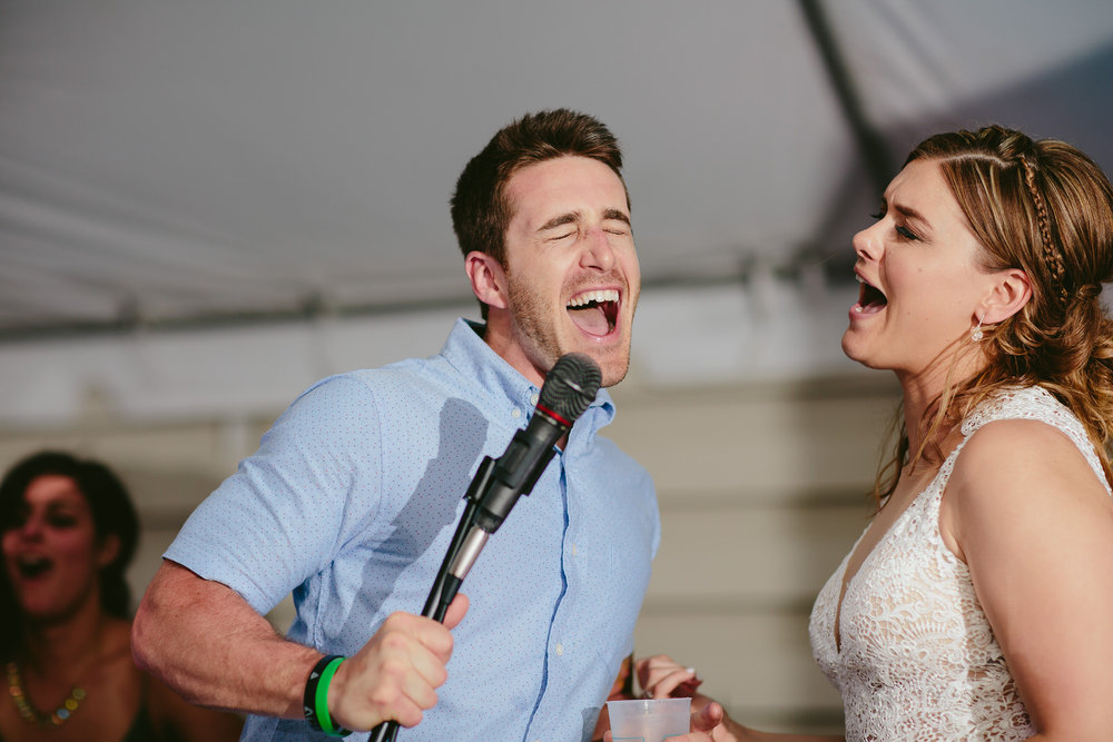 wedding_guests_fun_stage_singing_tiny_house_photo.jpg