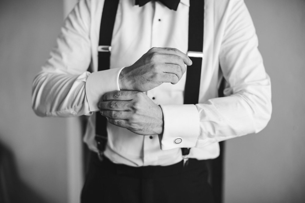 groom_getting_ready_black_and_white_classic_photographer_tiny_house_photo.jpg