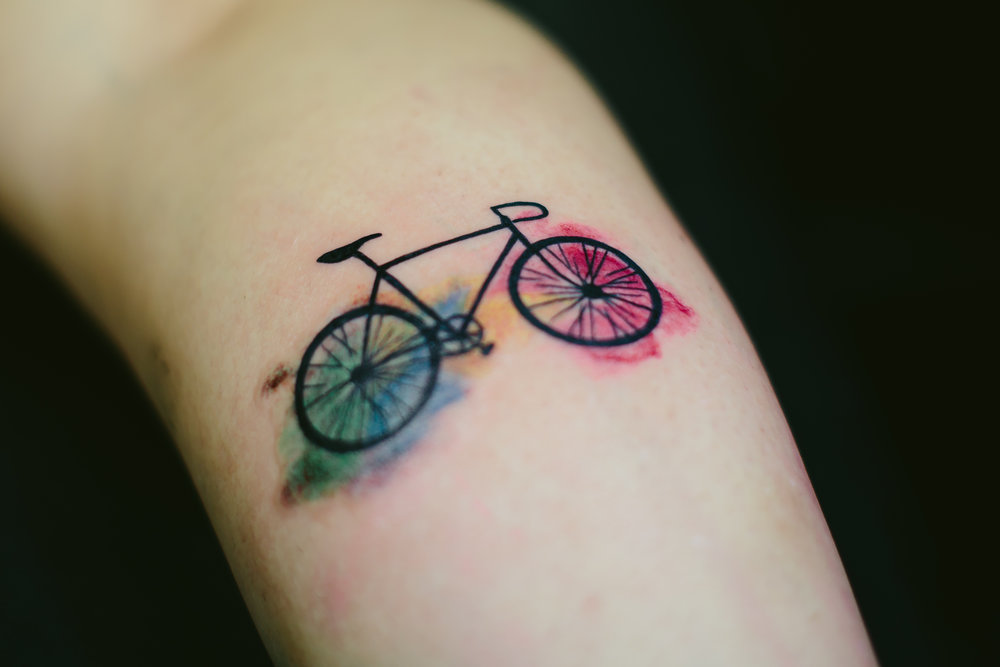 Bicycle tattoo with watercolor splatter with my best friends ashes.