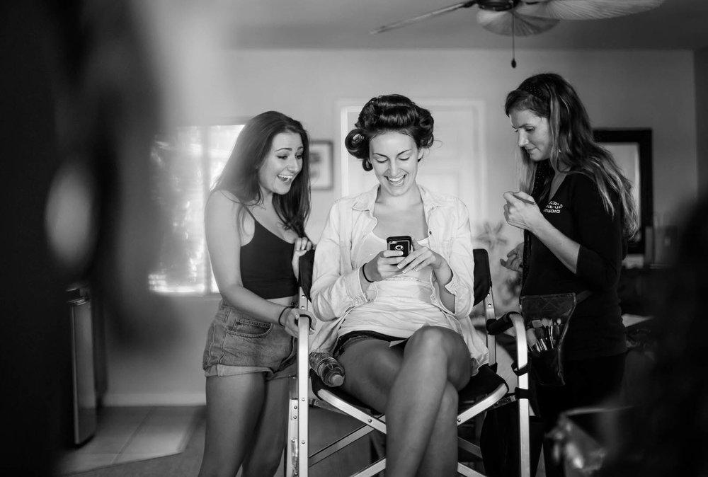 bride_laughing_makeup_chair.jpg