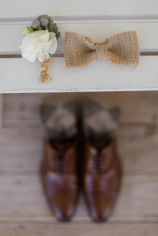 groom_details_bowtie_flower.jpg