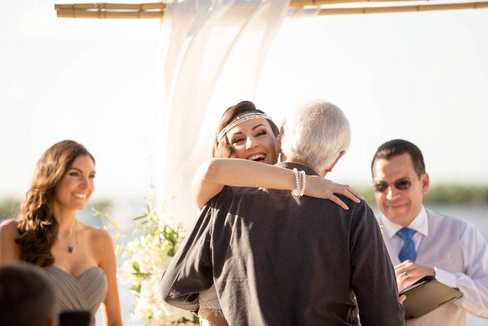 bride_hugging_dad_destination_wedding.jpg