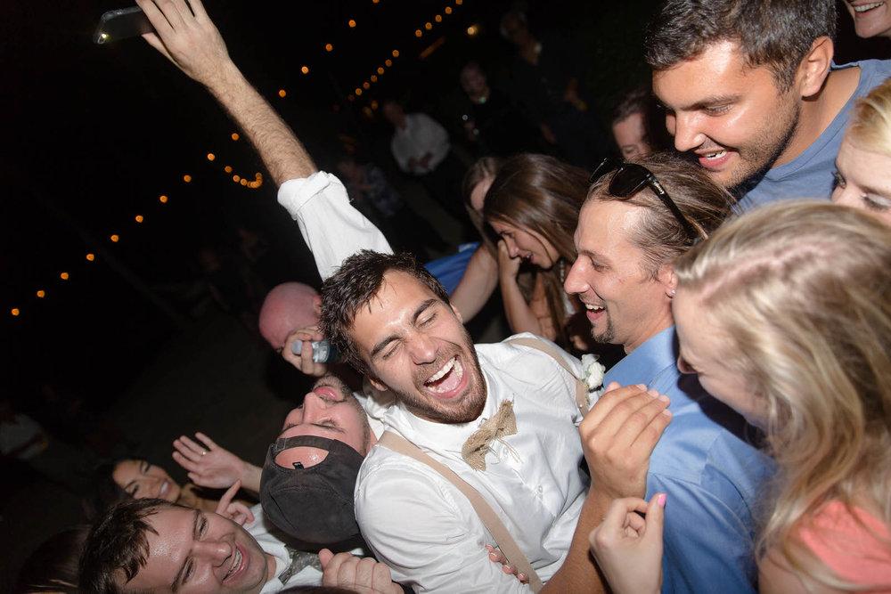 groom_fun_laughing_wedding_guests_drunk_reception.jpg