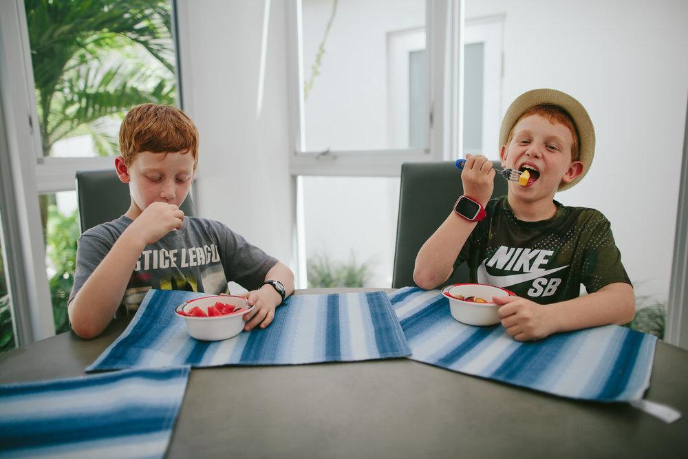 brothers_eating_fruit_tiny_house_photo.jpg