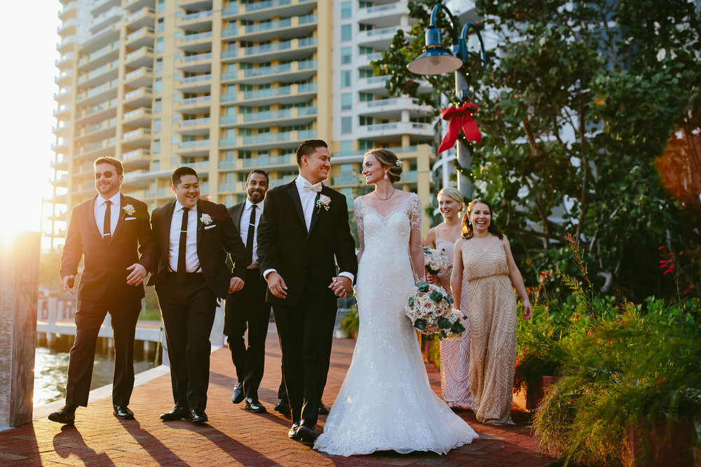 Fun Wedding Party strolling up the Riverfront in Fort Lauderdale after this Stranahan House Wedding