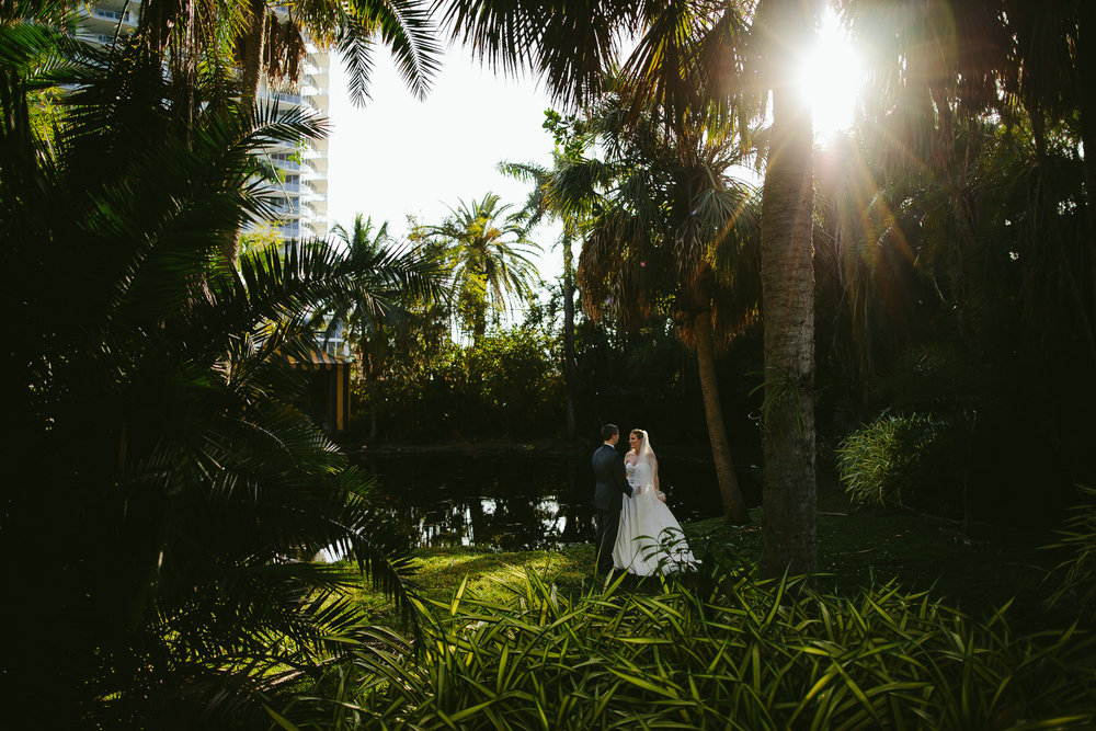 Gorgeous greenery surrounds the Bride and Groom at the Bonnet House in Fort Lauderdale, FL