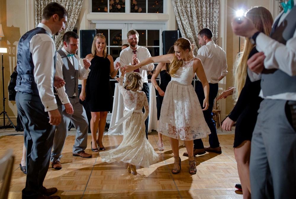A gorgeous bride twirls her flowergirl on the dance floor during her luxury wedding in Bal Harbor, FL