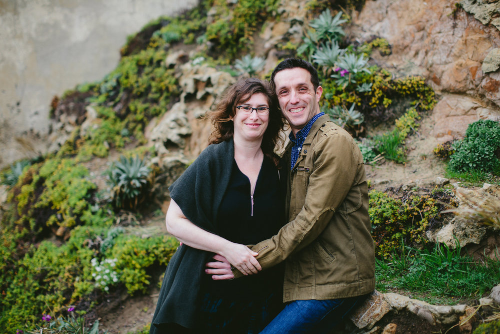 happy_engaged_couple_san_francisco_sutro_baths_tiny_house_photo.jpg