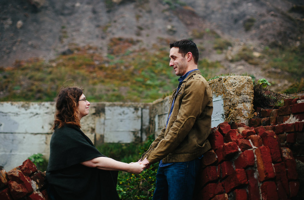 sutro_baths_engagement_session_holding_hands_in_love_and_life.jpg
