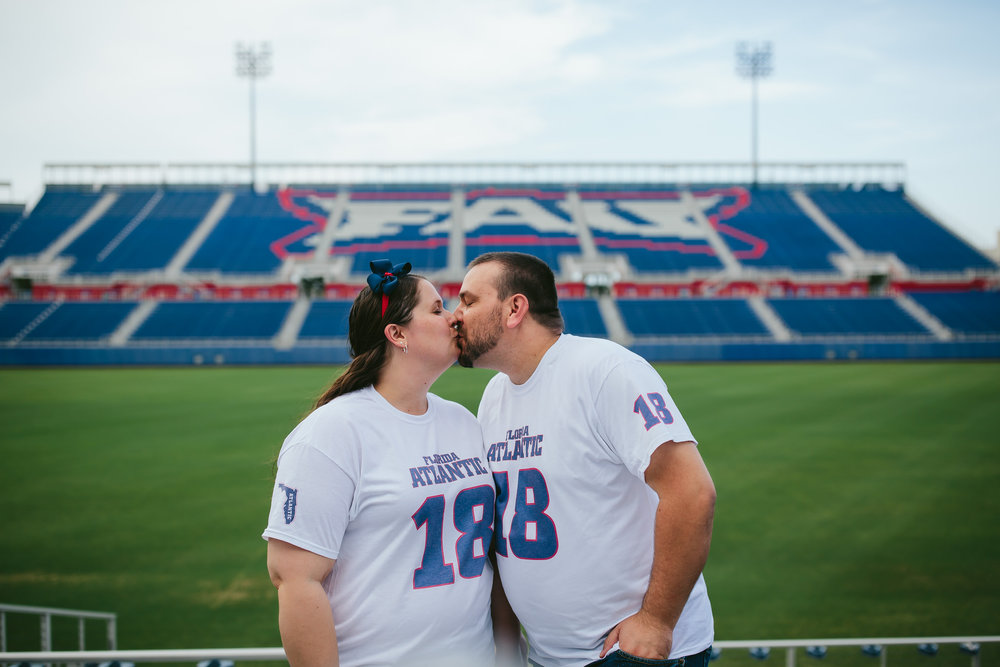 fau_college_football_engagement_session_kissing_boca_raton.jpg