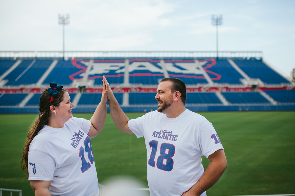 fau_college_football_engagement_session_high_five_couple