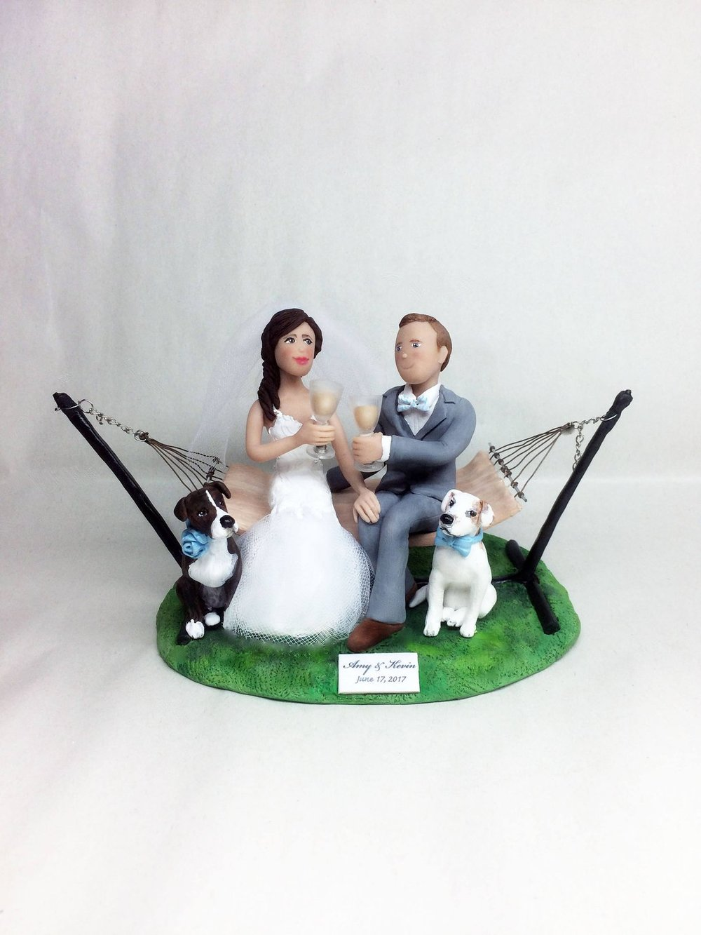 Custom Cake Toppers can be found on Etsy such as this one from Barbara's Clay Magic