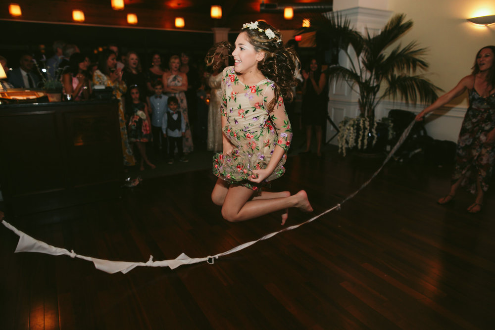 playing-jump-rope-wedding-reception-jensen-beach-wedding-photographer-tiny-house-photo