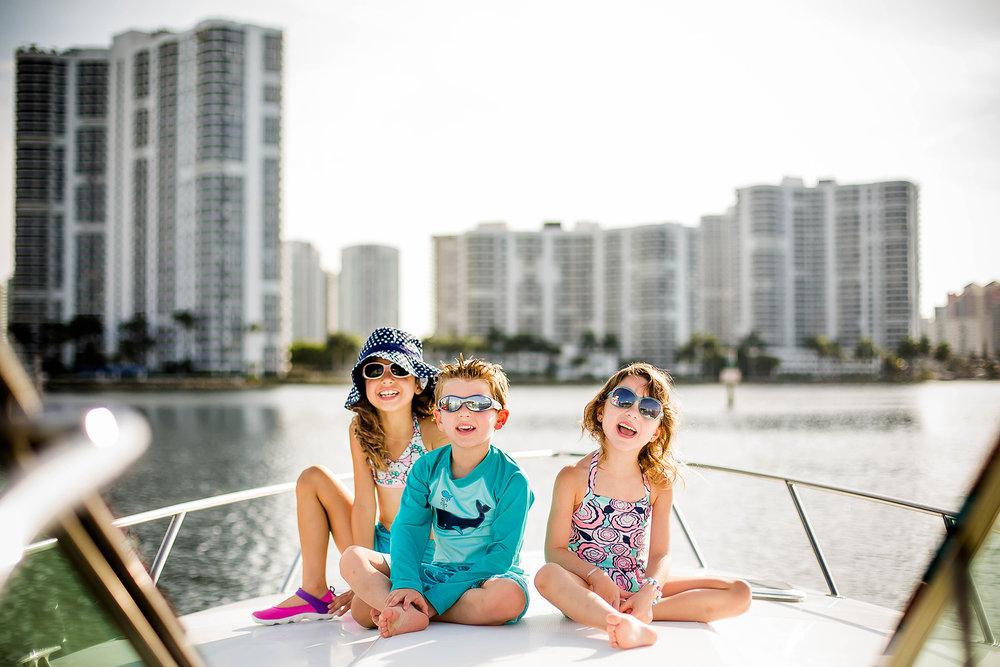 miami-aventura-family-photographer-childhood-boat-fun-lifestyle-adorable-summer-fun.jpg