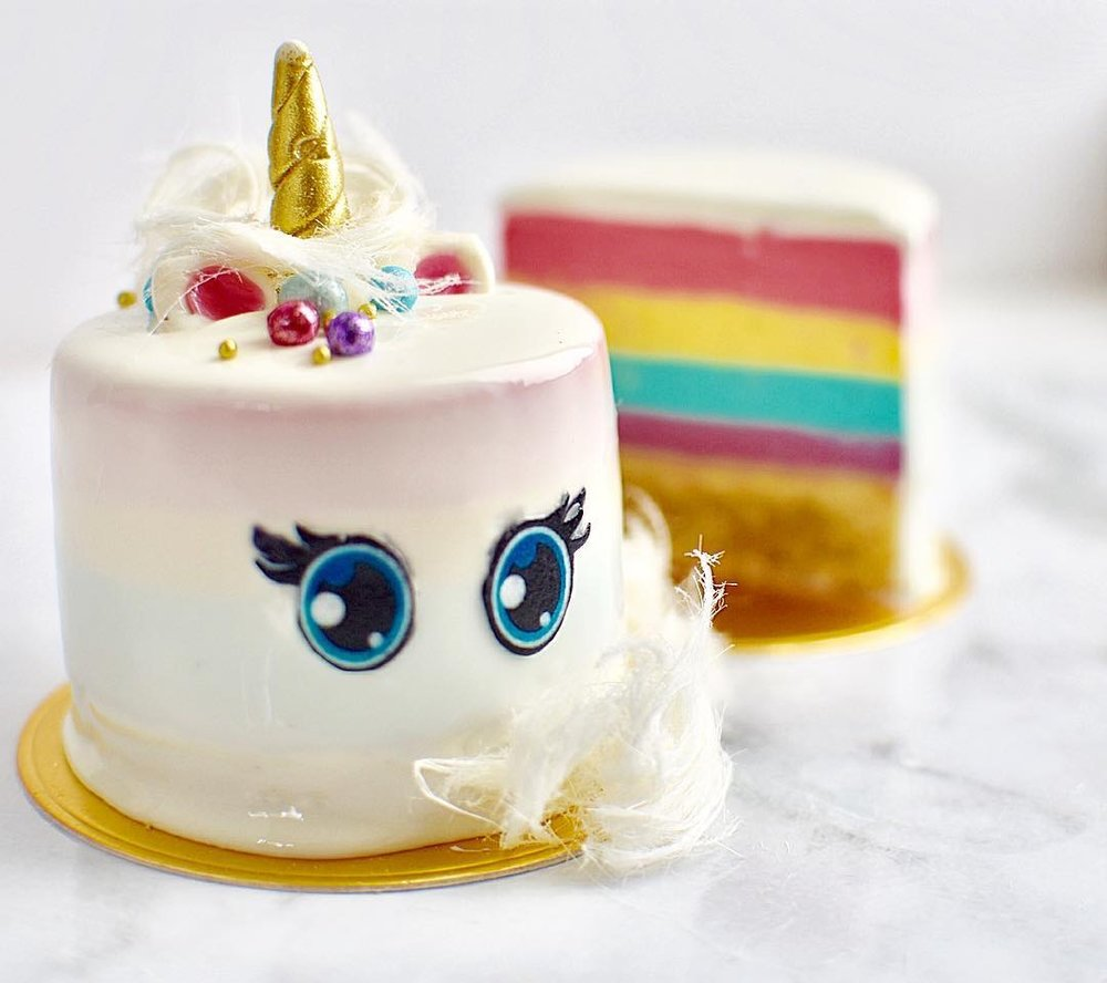 BABY UNICORN CHEESECAKE  Biscuit base, rainbow vanilla bean flavoured cheesecake, mirror glaze, edible image eyes and fondant garnishes.  $8.50 each  Minimum Order Quantity : 8