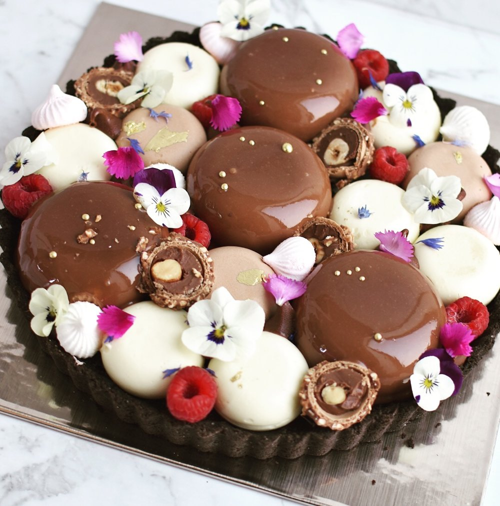 HARMONY TART  Oreo crumb base, nutella cheesecake and white chocolate mousse, nutella, ferrero, raspberries.  $69.00