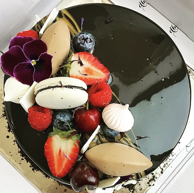 "BLACK FOREST ENTREMET  Chocolate sponge, Cadburys Milk Chocolate Mousse, Cherry Compote, Whipped Cream, Dark Chocolate Mirror Glaze, Mixed Berries, Macaron, White Chocolate Shards, Edible Flowers  6"" size $49.00 Feed upto 8  8"" size $69.00 Feed upto 12"