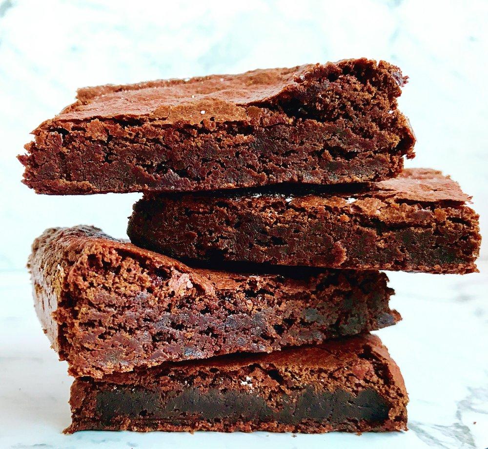 BROWNIES  Original DBE Fudge Brownies : $4.00 each  Lindt Choc Fudge Brownies : $4.50 each  Flourless Fudge Brownies : $4.00 each  Minimum Order Quantity : 15 per flavour