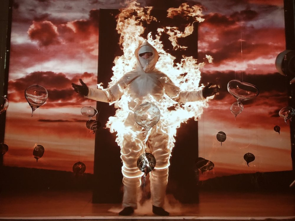 Cassils,  Inextinguishable Fire  (2015), 26 minute video projection . Encapsulated Breaths  (2017), hand-blown glass.   Photo courtesy the author.