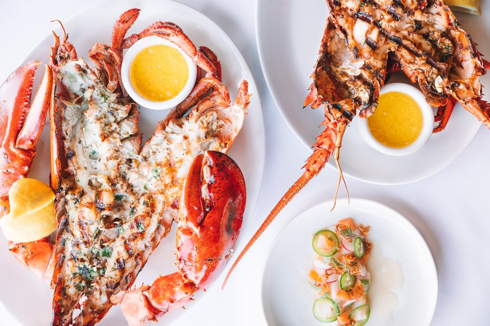 Grilled CA Spiny Lobster with fresh herbs, lemon & garlic butter
