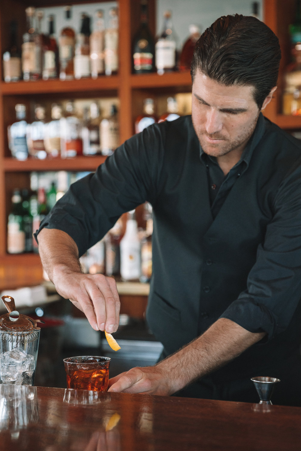 A Bartender making The Lobster Elyx Signature Cocktail