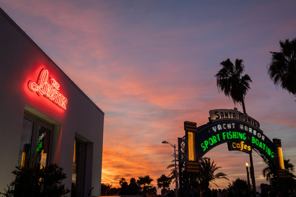 The Lobster Restaurant and Santa Monica sign at sunset