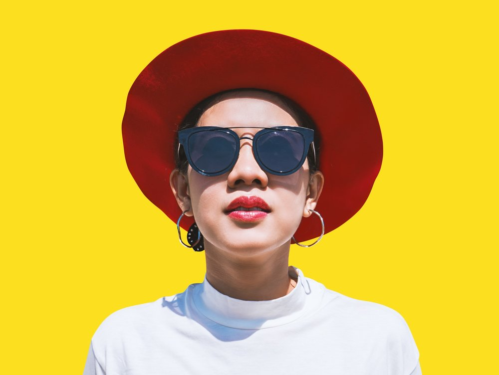 woman-portrait-in-red-summer-hat-and-sunglasses-over-colorful-yellow-background-summer-vacation_t20_R6E0bQ.jpg