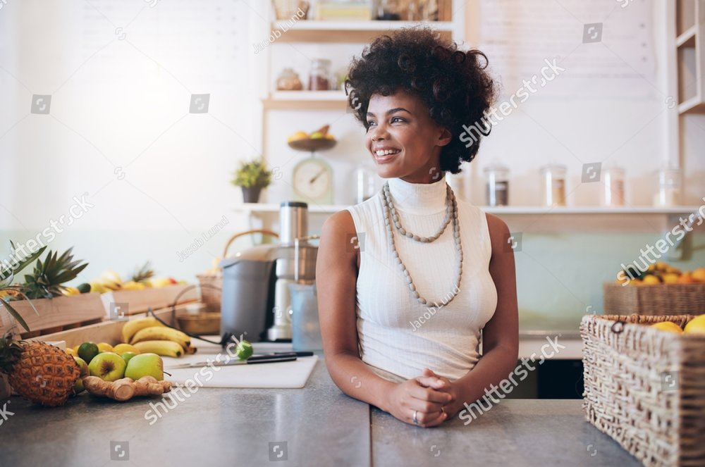 stock-photo-portrait-of-beautiful-young-woman-working-at-juice-bar-she-is-standing-behind-counter-looking-away-419352799.jpg