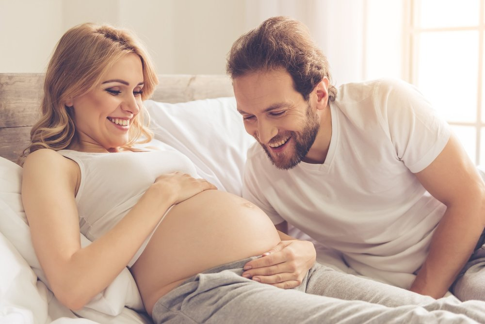bigstock-Happy-Couple-Waiting-For-Baby-159895136.jpg