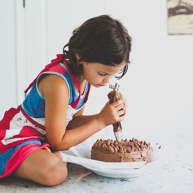 Young ladies (as she likes to be called) are capable of doing so much more than we think.  My sweet 7 year old sees herself as more of an adult than a child and takes offense to being called a little girl. She's got big dreams!  #kidswork #cakedecorating #kidscooking