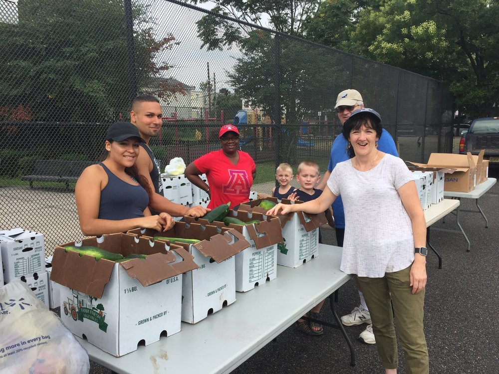 South Ridge volunteers at the Jersey City Free Farm Market, distributing produce picked at America's Grow-A-Row (2017)