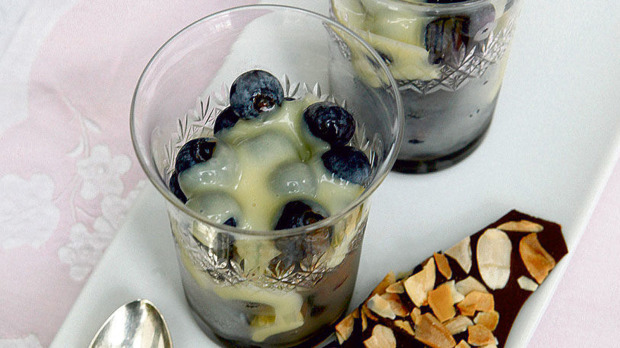 Iced blueberries with hot chocolate sauce and dark chocolate almond bark.jpg